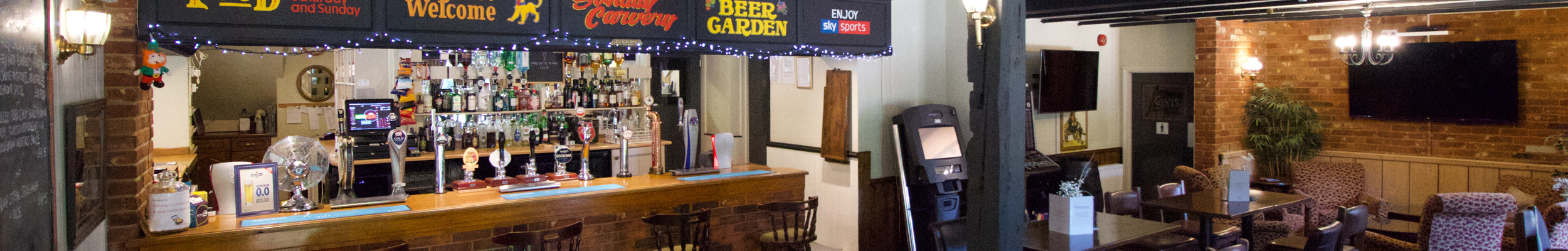 The Bar // The bar area of the Plough Inn with HD TV and wide selection of drinks