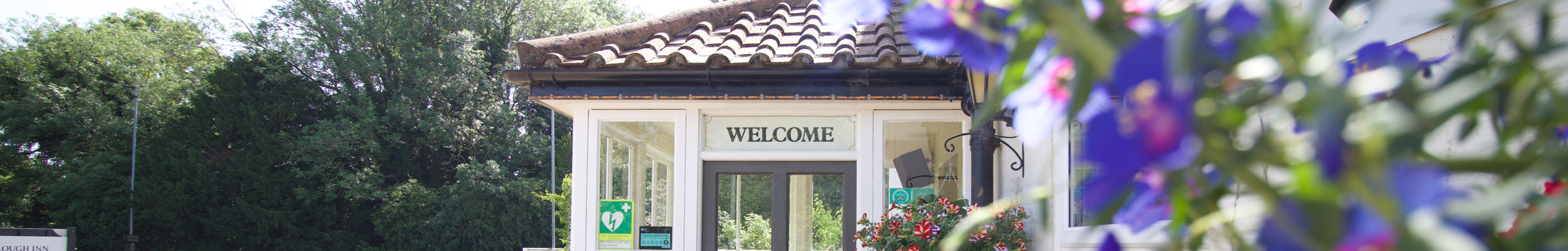 Room Gallery // Exterior shot of the entrance to The Plough Inn