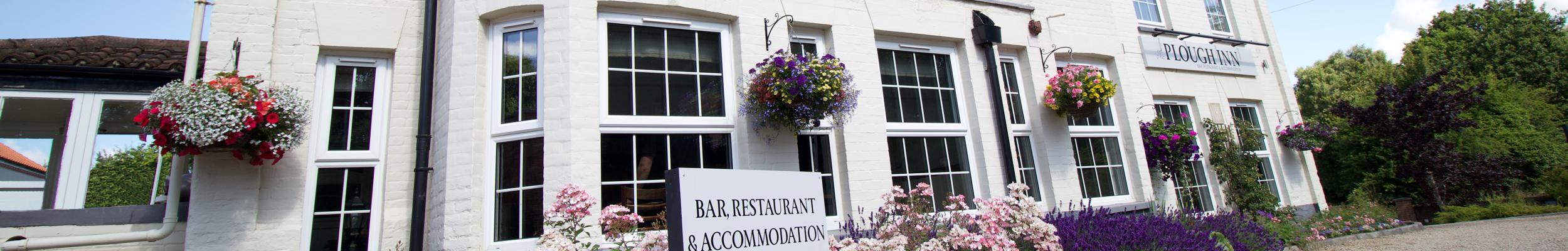 Reviews // Exterior shot of The Plough Inn Bar, Restaurant & Accommodation